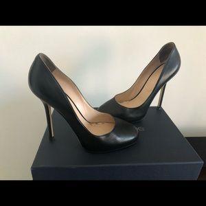 Black leather Sergio Rossi round toe pumps